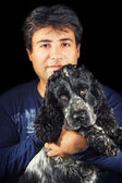 Man holding a cute black and white english cocker spaniel — Stock Photo