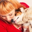 Redhead with a jack russell terrier - Stock Photo