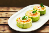 Zucchini stuffed with cheese and vegetables — Stock Photo