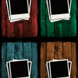 Polaroids over colorful grunge wooden walls - Stock Photo