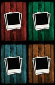 Polaroids over colorful grunge wooden walls — Stock Photo