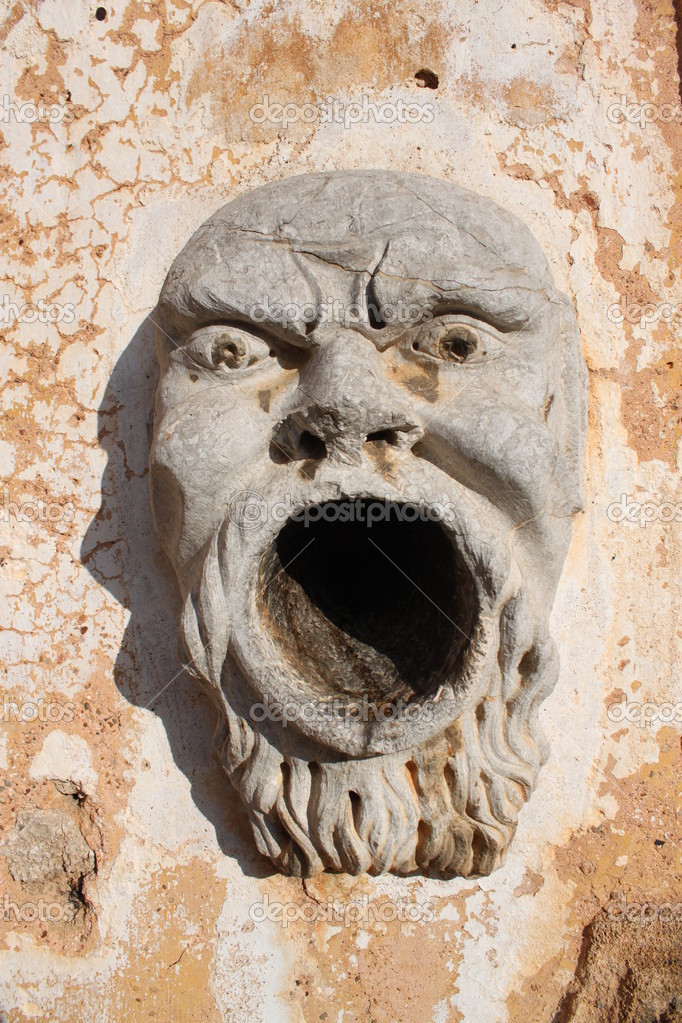 Monster face sculpture statues, works of art with the Sicilian style — Stock Photo #7149830