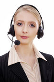 Female call center employee with headset — Stock Photo