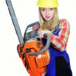 Young woman with a chainsaw — Stock Photo #7670615