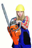 Young woman with a chainsaw — Stock Photo