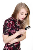 Girl with a magnifier — Stock Photo