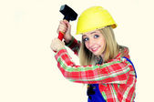 Young woman with helmet and hammer — Stock Photo