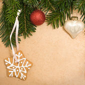 Vintage Christmas background with green fir tree, cookies and xm — Stock Photo