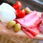 Italian cuisine. Gourmet food - salami, olives, mozzarella — Stock Photo