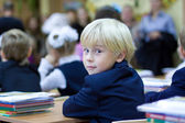 Back in school - boy in the classroom — Stock Photo