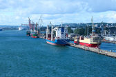 Port, dock and ships in city - logistics — Stock Photo