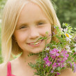 Smiling girl with flowers - happiness — Stock Photo