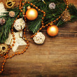 Christmas background with golden decoration, star and xmas tree — Photo #7658494