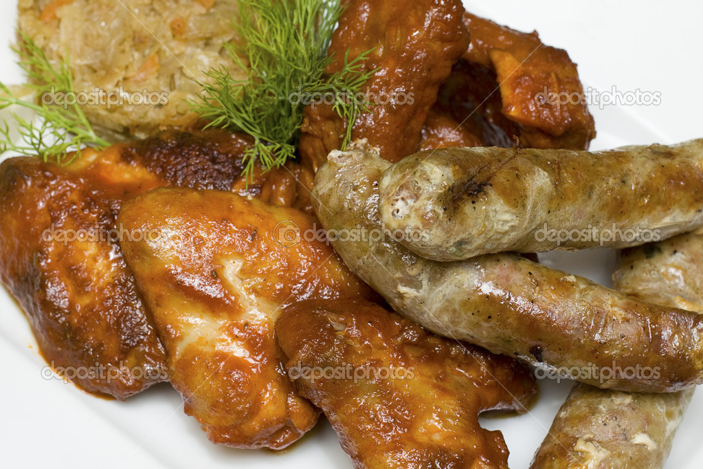 Snack - chicken wings, sausages, pork ribs and cabbage - German cuisine — Stock Photo #7658424