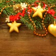 图库照片: Christmas decoration, red ribbon and Xmas tree on blurred wooden