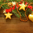 Stock Photo: Christmas decoration, red ribbon and Xmas tree on blurred wooden