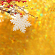 Christmas background with snowflake, red berry and golden bokeh — Stock Photo #7674967