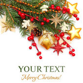 Christmas background - Xmas tree, gold decoration, red berry iso — Stock Photo