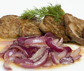Gourmet restaurant food - veal with red onion — Stock Photo
