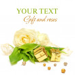 Stock Photo: Gift, rose flowers and gold ribbon on white - luxury background
