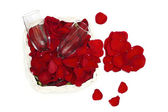 Rose petals, heart and two glasses of wine - love concept — Stock Photo
