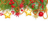 Christmas concept - Xmas tree branch and decoration isolated on — Stock Photo