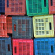 Colorful plastic crates background — Stock Photo