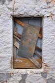 Old boarded up window frame background — Stock Photo