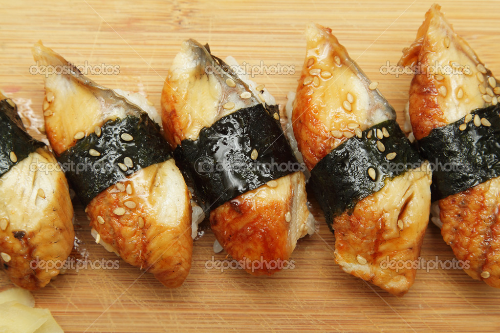 Group of broiled eel (unagi) sushi with sesame seeds  Stock Photo #6909196