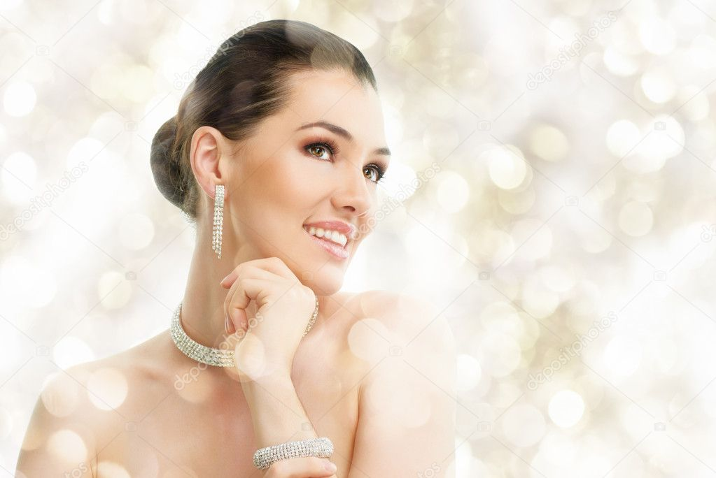 Portrait of beautiful woman with jewelry  Stock Photo #7586622