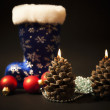 Christmas-tree decorations and christmas candles with dark blue — Stock Photo