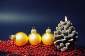 Christmas card with gold balls and candles — Stock Photo