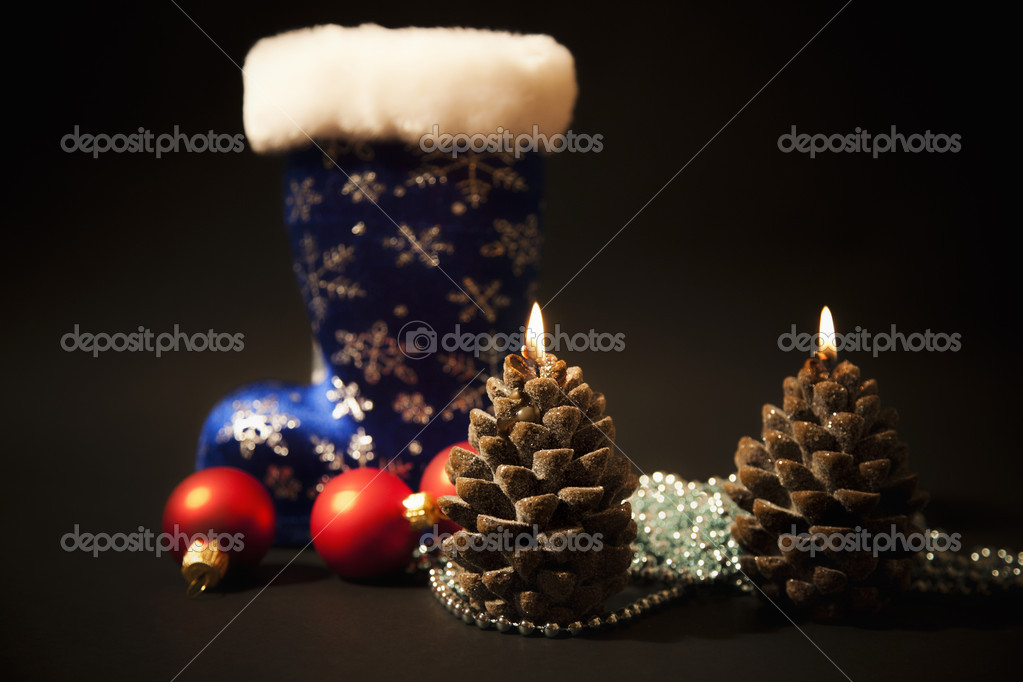Christmas-tree decorations and christmas candles with dark blue  boot on  black background — Lizenzfreies Foto #7807924