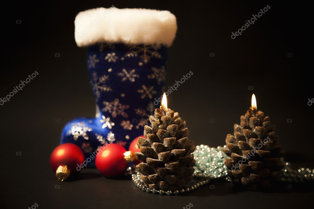 Christmas-tree decorations and christmas candles with dark blue  boot on  black background — Photo #7807924