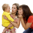 Mother and the aunt have fun together with the child — Stock Photo