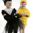Royalty-Free Stock Photo: Two girls play in fancy dress of a chicken and cat. Isolated whi