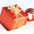 Box with a gift and Christmas Balls — Stock Photo