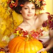 Portrait of beautiful girl with autumn leaves — Foto de Stock