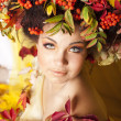 Portrait of beautiful girl with autumn leaves - Stok fotoğraf