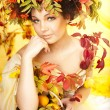 Portrait of beautiful girl with autumn leaves — Stok fotoğraf