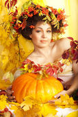 Portrait of beautiful girl with autumn leaves — Стоковое фото