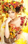 Portrait of beautiful girl with autumn leaves — Photo