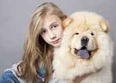 Girl and dog Chow chow — Stock Photo