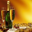 Glass of champagne against golden background — Stock Photo #6838505