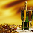 Glass of champagne against golden background — Stock Photo #6838587