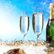 Glass of champagne against blue background . new year — Stock Photo