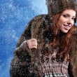 Stock Photo: Beautiful womin winter fur coat