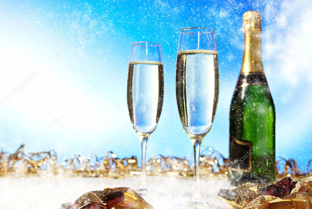Glass of champagne against blue background  — Stock Photo #6839672
