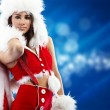 Beautiful sexy girl wearing santa claus clothes — Stock Photo #6844304