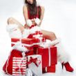 Stock Photo: Christmas woman with gifts box